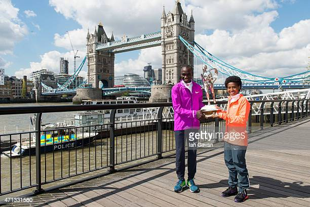 Kenya men's winner Eliud Kipchoge and Ethiopian women's winner Tigist Tufa pose during a photocall after winning the London Marathon at the Tower...