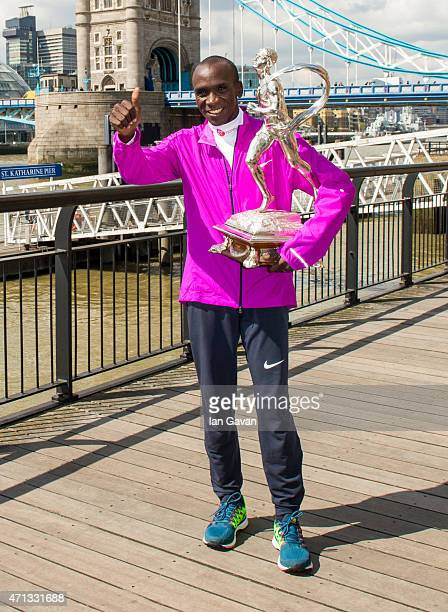 Kenya men's winner Eliud Kipchoge poses during a photocall after winning the London Marathon at the Tower Hotel on April 27 2015 in London England
