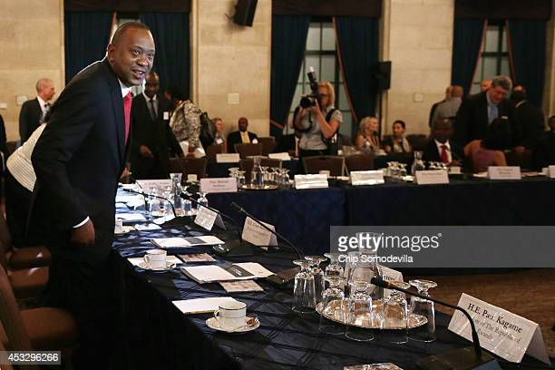Kenya President Uhuru Kenyatta arrives for a roundtable discussion with fellow East African presidents and American and African business leaders at...