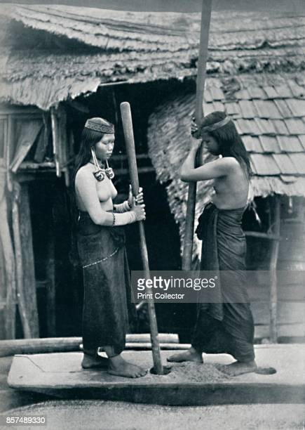 Kenyah women pounding rice Sarawak 1902 From The Living Races of Mankind Vol I [Hutchinson Co London 1902] Artist Dr Charles Hose