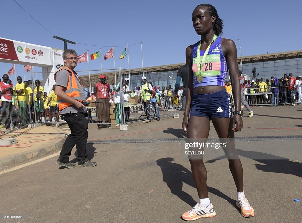 Kenyan athlete Beatrice Cherop poses after winning the female category of the first 42,195km-long Dakar International Marathon in Dakar on February 14, 2016. The competition organised by the BTP Eiffage society started on February 13 in front of International Conference Center Abou Diouf (Cicad) on the outskirts of Dakar with different runs of 10 km and will end the day after, February 14, with a marathon. The BTP Eiffage society hosted the event to celebrates its 90 years of presence in Senegal. / AFP / SEYLLOU