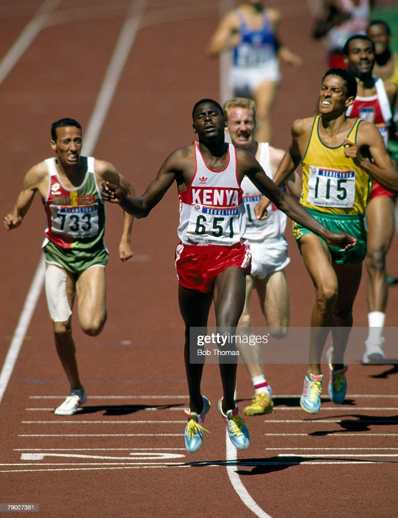 Kenyan athlete Paul Ereng crosses the line in first place to win the gold medal in the final of the Men's 800 metres event inside the Olympic Stadium...