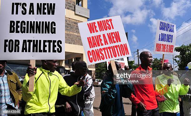 Kenyan athletes hold placards during a protest in Nairobi to demand that officials accused of corruption be sacked and for doping allegations to be...