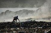 Kenyan boy scavenges at Kibarani dump