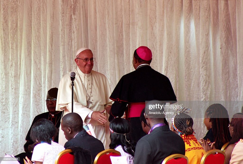 Kenyan Cardinal John Njue (R) welcomes Pope Francis (L) as he arrives at the Kasarani stadium in Nairobi, Kenya on November 27, 2015.
