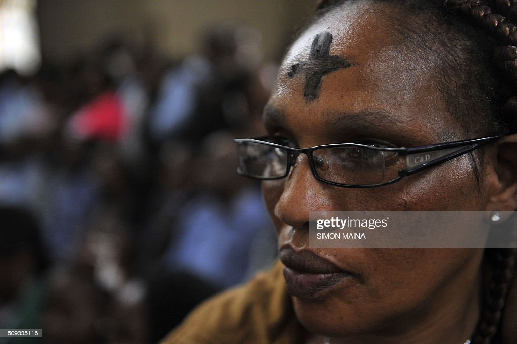 A Kenyan Catholic faithful looks on during a Lent mass on February 10, 2016 at the Holy family Basilicah in Nairobi. Lent takes place from February 10 till March 26, 2016 and is a solemn observance in the liturgical year of many Christian denominations, lasting for a period of approximately six weeks leading up to Easter Sunday. / AFP / SIMON MAINA