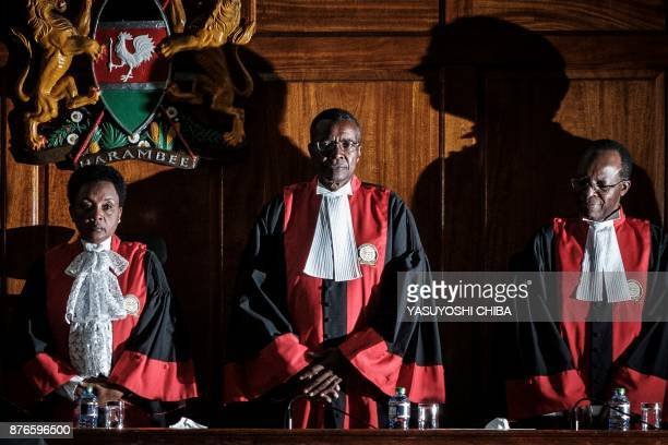 Kenyan Chief Justice David Maraga and judges stand prior to speak as the Kenya's Supreme Court on November 20 2017 dismissed two petitions to...