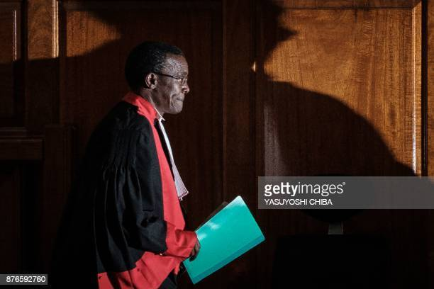 Kenyan Chief Justice David Maraga enters prior to speak as the Kenya's Supreme Court on November 20 2017 dismissed two petitions to overturn the...