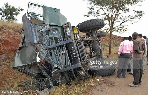Kenyan civilians look at the wreckage of a military truck on September 11 2008 that lost control and rolled near Thika town 40 kilometres northeast...