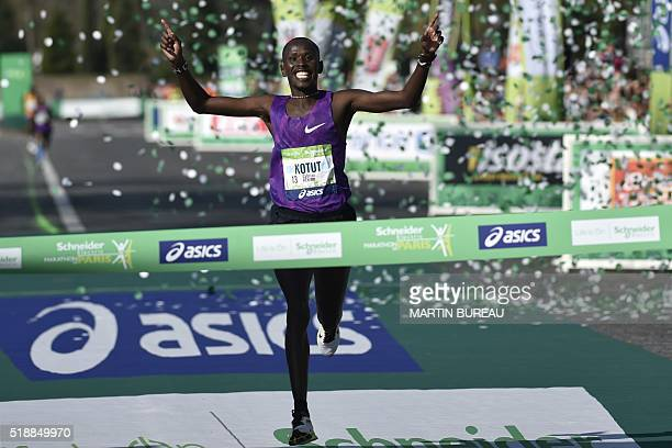 Kenyan Cyprian Kotut passes the finish line as he wins the 40th Paris Marathon on April 3 2016 in Paris Some 57000 participants from 160 countries...