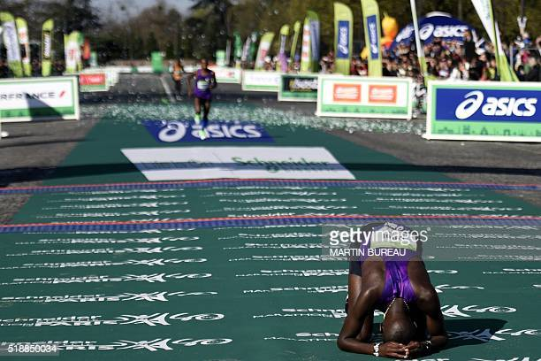 Kenyan Cyprian Kotut reacts after winning the 40th Paris Marathon on April 3 2016 in Paris Some 57000 participants from 160 countries have registered...