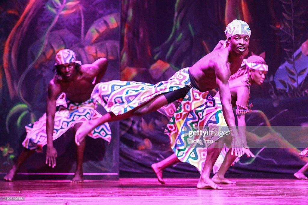 Kenyan dancer of the Safari Cats Dancers group performs at Nairobis Safari Park Hotel whilst wearing a traditional African regalia