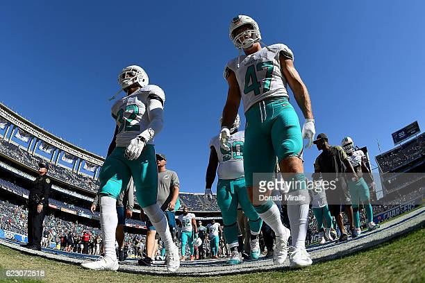 Kenyan Drake and Kiko Alonso of the Miami Dolphins walk on the field for a game against the San Diego Chargers at Qualcomm Stadium on November 13...