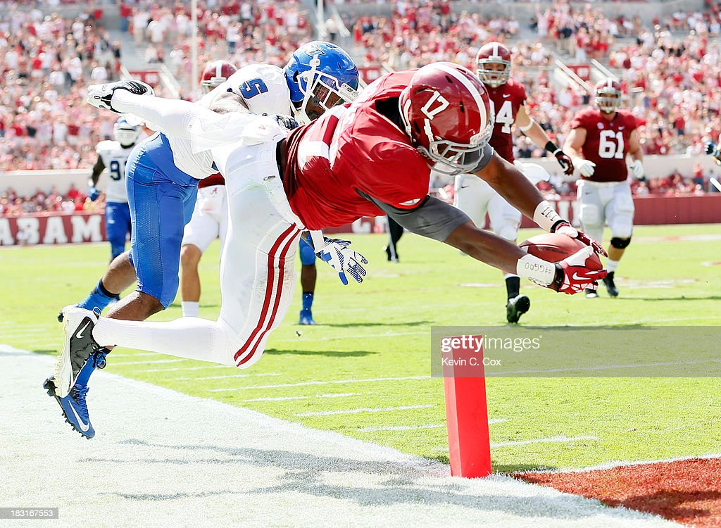 Kenyan Drake #17 of the Alabama Crimson Tide dives for a touchdown against Demarius Matthews #5 of the Georgia State Panthers at Bryant-Denny Stadium on October 5, 2013 in Tuscaloosa, Alabama.