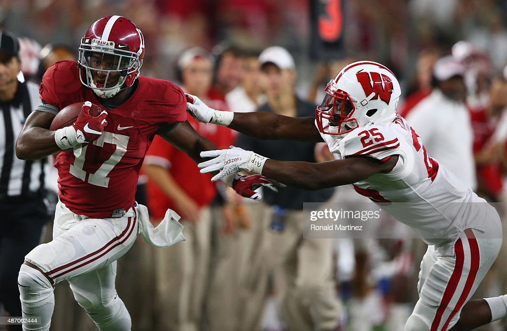 Kenyan Drake of the Alabama Crimson Tide runs for a touchdown past Derrick Tindal of the Wisconsin Badgers in the fourth quarter during the Advocare...