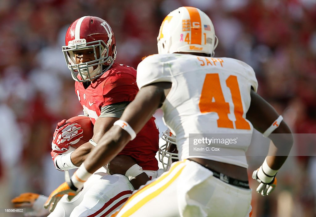 Kenyan Drake #17 of the Alabama Crimson Tide rushes against Dontavis Sapp #41 of the Tennessee Volunteers at Bryant-Denny Stadium on October 26, 2013 in Tuscaloosa, Alabama.