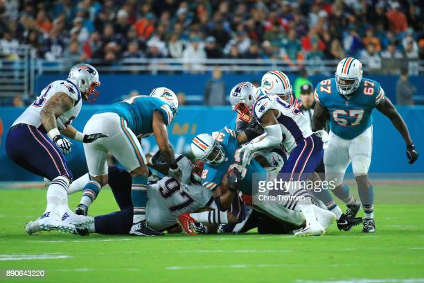Kenyan Drake of the Miami Dolphins rushes during the first quarter against the Miami Dolphins at Hard Rock Stadium on December 11 2017 in Miami...