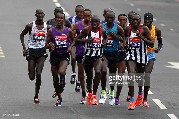 Kenyan Eliud Kipchoge crosses Tower Bridge on his way to winning the Virgin Money London Marathon on April 26 2015 in London England