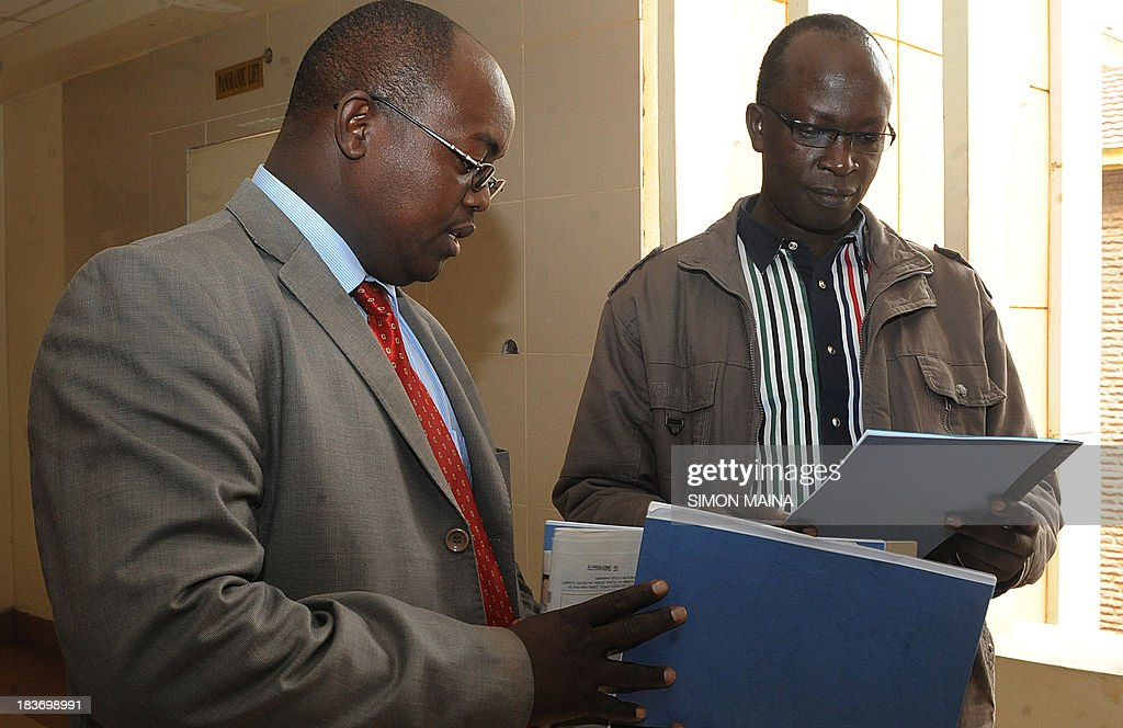 Kenyan ex-journalist Walter Barasa (R) and his lawyer Kibe Muigai check documents as they arrive on October 9, 2013 at the Nairobi Law court to file an urgent application to stop his arrest and handing over to the International Criminal Court (ICC). The International Criminal Court said on October 2 it had issued a warrant for the arrest of Walter Barasa for allegedly trying to bribe witnesses to drop their testimony in the crimes against humanity trial of Deputy President William Ruto. Barasa, 41, 'is charged with several offences against the administration of justice including corruptly influencing or attempting to corruptly influence ICC witnesses,' the Hague-based ICC said in a statement. MAINA