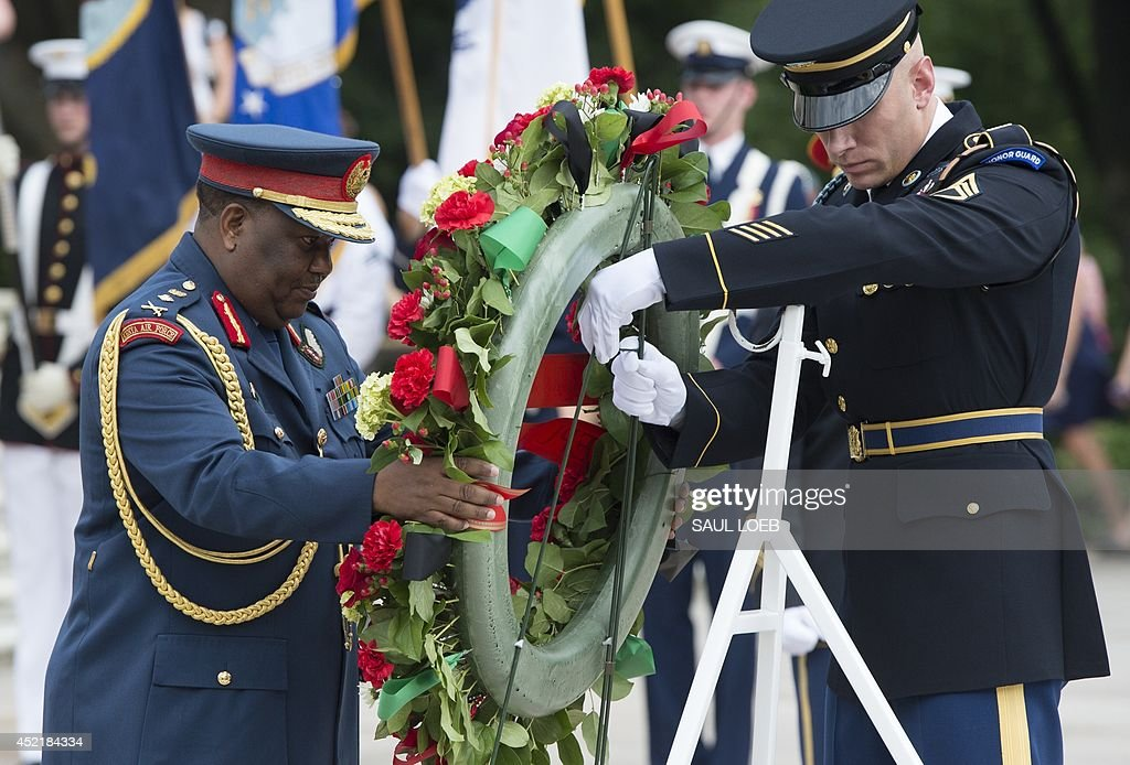 Kenyan General Julius Waweru Karangi Chief of the Kenyan Defense Forces participates in a wreath laying ceremony at the Tomb of the Unknown Soldier...