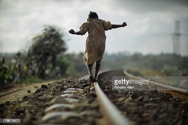Kenyan girl walking on train tracks