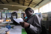 Kenyan Independent Electoral and Boundaries Commission officials finalise ballotcounting at a polling station on March 6 2013 in the Mathare slum in...