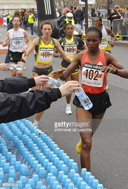 Kenyan Lena Sheruiyot competes during the 16th edition of Paris halfmarathon on March 02 2008 Sheruiyot won the event AFP PHOTO / STEPHANE DE SAKUTIN