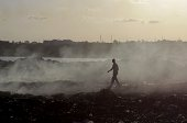 Kenyan male walks across Kibarani dump