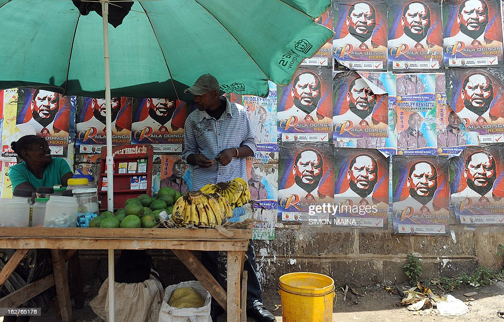 A Kenyan man buys bananas next to a poster advertising Presidential candidate and Prime Minister Raila Odinga on February 26, 2013 in the sprawling Kibera slums. Kenya is gearing up for presidential, gubernatorial, senatorial elections on March 4, the first since bloody post-poll violence five years ago in which more than 1,100 people died after contested results.