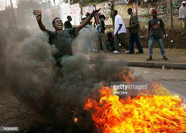 A Kenyan man demonstrates in the Kibera slums on January 17 2008 in Nairobi Kenya International mediators have attempted to unlock political gridlock...