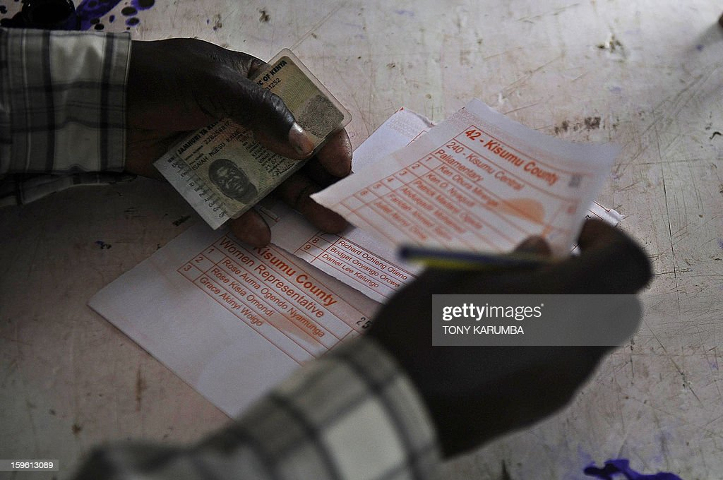 A Kenyan man fills out a ballot as he votes in political party primary nominations on January 17, 2013, in the lakeside town of Kisumu, ahead of this year's general election to be held in March. The March 2013 elections are the first since the bloody 2007-08 polls that left at least 1,100 killed and 600,000 more displaced after what began as protests over the election results degenerated into vicious killings pitting supporters of Prime Minister Raila Odinga against those of the outgoing president Mwai Kibaki. AFP PHOTO / Tony KARUMBA