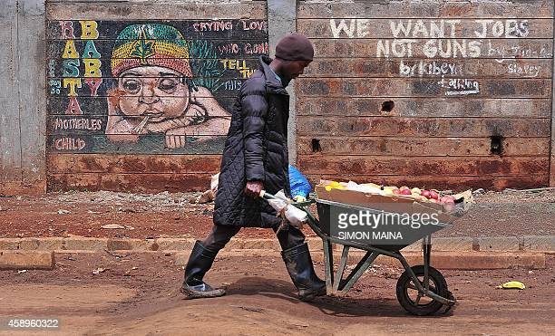 A Kenyan man hawks fruits in the Kibera slum on November 14 2014 in NairobiAFP PHOTO/SIMON MAINA