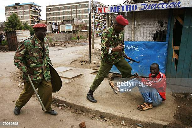 A Kenyan man is confronted by Kenyan police during clashes in the Mathare slums January 17 2008 in Nairobi Kenya International mediators have...