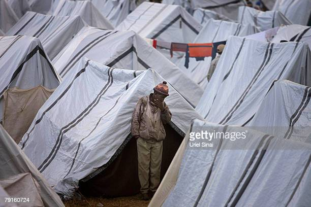 A Kenyan man looks thoughtful standing amongst the tents of the Kenyan Internally Displaced People campsite in the show ground stadium on January 22...