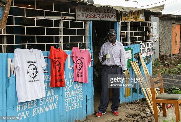 Kenyan man stands in front of a shop displaying Tshirts bearing an image of Obama in Keynan capital Nairobi on July 24 ahead of the US President...