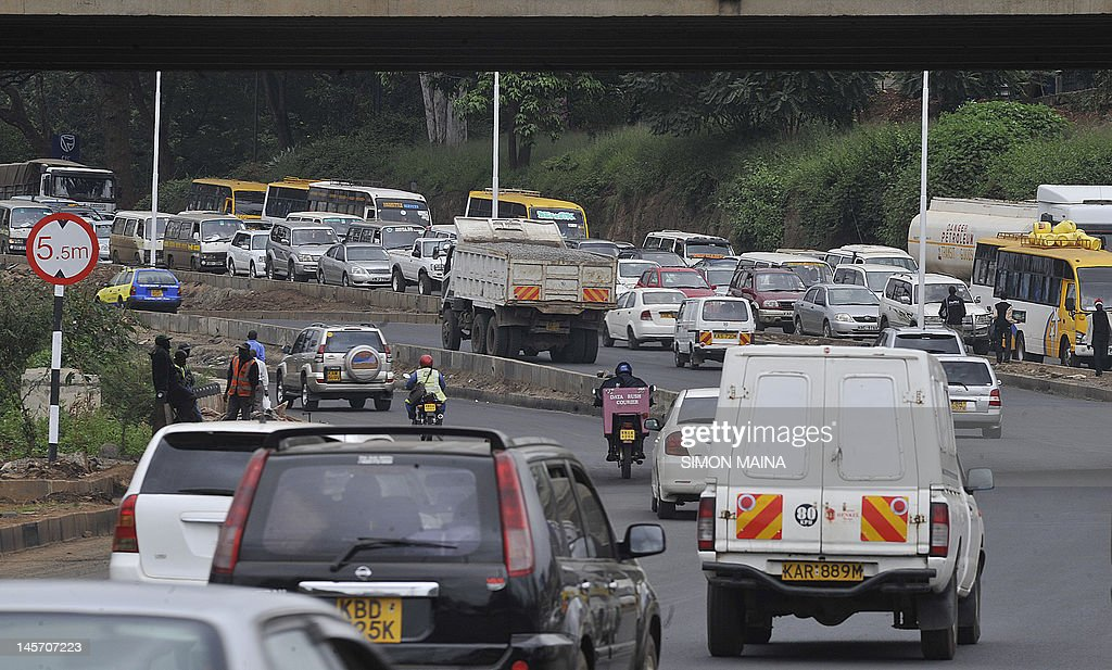 Kenyan motorists drive on June 4, 2012 in heavy traffic in the country's capital Nairobi. According to an IBM Commuter Pain Survey, Nairobi residents have the fourth most painful commute in the world. City officials estimate that traffic jams cost the economy over 600,000 US dollars (482,600 euros) per day in lost productivity, fuel consumption and pollution. It has been estimated that the population of Nairobi will increase from the current 3 million to 4.3 million in 2025, hence the urgent need to upgrade the city's roads. AFP PHOTO / SIMON MAINA