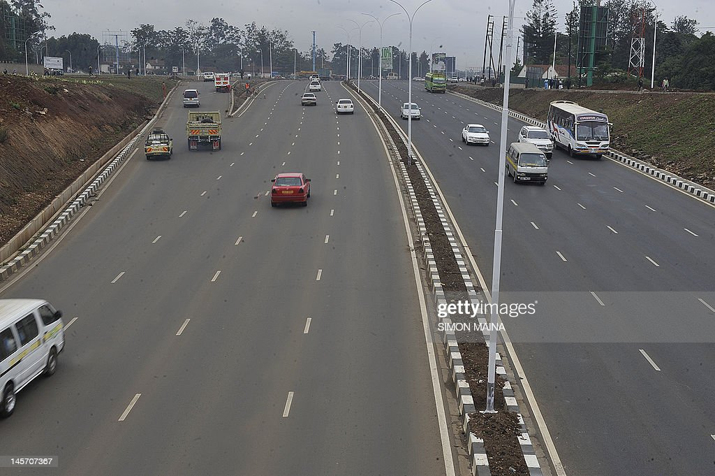 Kenyan motorists drive on June 4, 2012 on the newly upgraded highway on Thika road, which has helped ease traffic in the country's capital Nairob. According to an IBM Commuter Pain Survey, Nairobi residents have the fourth most painful commute in the world. City officials estimate that traffic jams cost the economy over 600,000 US dollars (482,600 euros) per day in lost productivity, fuel consumption and pollution. It has been estimated that the population of Nairobi will increase from the current 3 million to 4.3 million in 2025, hence the urgent need to upgrade the city's roads. AFP PHOTO / SIMON MAINA