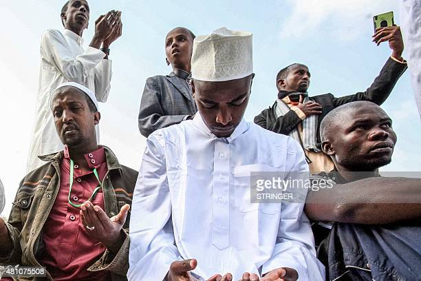 Kenyan Muslims gather to celebrate Eid alFitr prayer marking the end of the fasting month of Ramadan at the Sir Ali Muslim club in Nairobi on July 17...
