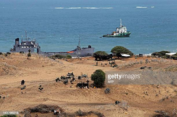 A Kenyan naval ship is pictured at shore in the Somali port city of Kismayo on October 2 2012 Blasts rocked the Somali port city of Kismayo on...
