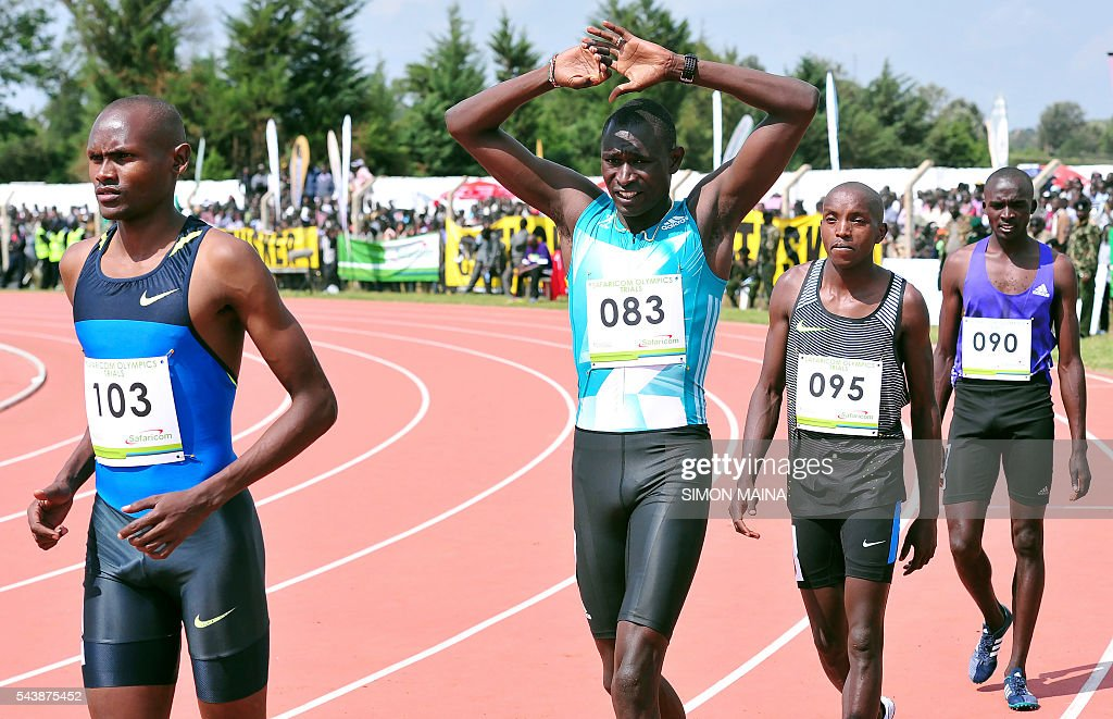 Kenyan Olympic champion David Rudisha (2nd L) warms up before the race on June 30, 2016, during the Olympic selection trials at the Kipchoge stadium in Eldoret. / AFP / SIMON