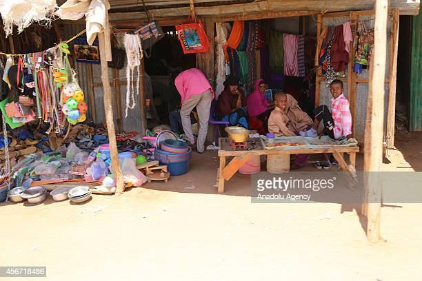 Kenyan people sit in front of a shop during Eid alAdha in Dadaab Kenya on October 5 2014