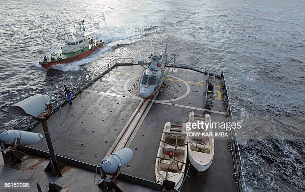 A Kenyan pilot boat arrives next to the French frigate 'Nivose' on April 22 2009 as it approaches the Kenyan port of Mombasa to deliver 11 suspected...