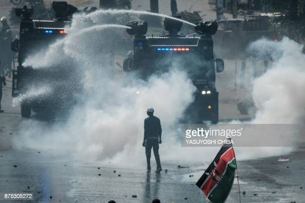 Kenyan police clash with supporters of Kenyan's opposition party National Super Alliance leader Raila Odinga upon his arrival to the Jomo Kenyatta...