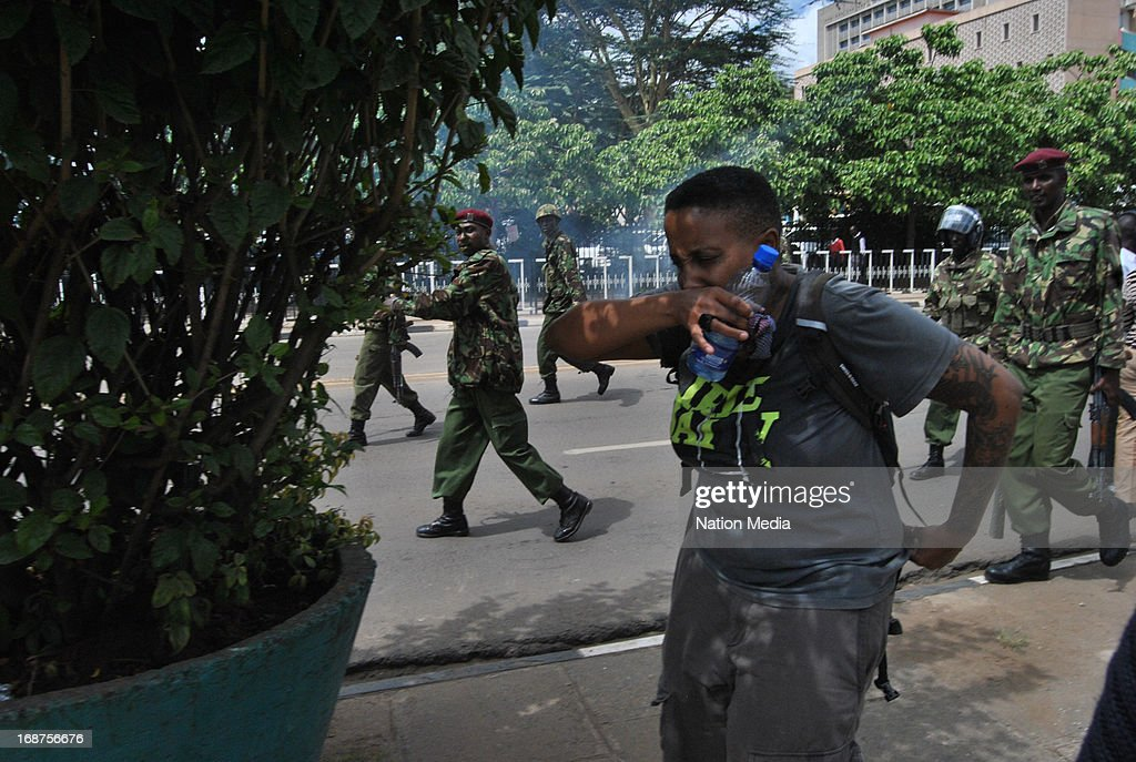 Kenyan police fire teargas at protesters during a pig protest on May 14, 2013 in Nairobi, Kenya. The protesters released a pig and about a dozen piglets outside parliament to show their anger at newly elected MPs demanding higher salaries. The protest was intended to portray the MPs as greedy.
