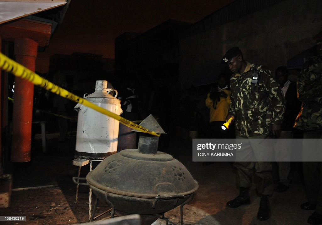 A Kenyan police officer secures the scene of a grenade attack on December 16, 2012 in Nairobi's mainly Somali ethnic neighbourhood of Eastleigh. A huge blast shook the predominantly Somali neighbourhood of Eastleigh in the Kenyan capital Nairobi this evening after three grenades targeted at a local bar and restaurant were lobbed injuring atleast two people, police said. Witnesses say there were at least three separate blasts and that the explosions occurred near a bar, which follows another recent grenade attack outside a mosque in the same neighbourhood that killed at least five people as well as wounding the local member of parliament. AFP PHOTO/Tony KARUMBA