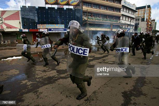 Kenyan police run in the streets during clashes in central Nairobi Kenya on January 16 2008 International mediators have attempted to unlock...