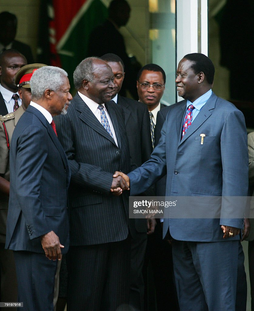 Kenyan President Mwai Kibaki (C) shakes the hand of Kenya's opposition leader Raila Odinga (R) as former UN Chief Kofi Annan (L) looks on after they met for the first time 24 January 2008 since the controversial 27 December presidential elections. Kibaki and Odinga smiled and shook hands after walking out from their brief meeting at the president's office, their first face-to-face talks since the December 27 elections broke into violence that has claimed close to 800 lives. AFP PHOTO/Simon MAINA