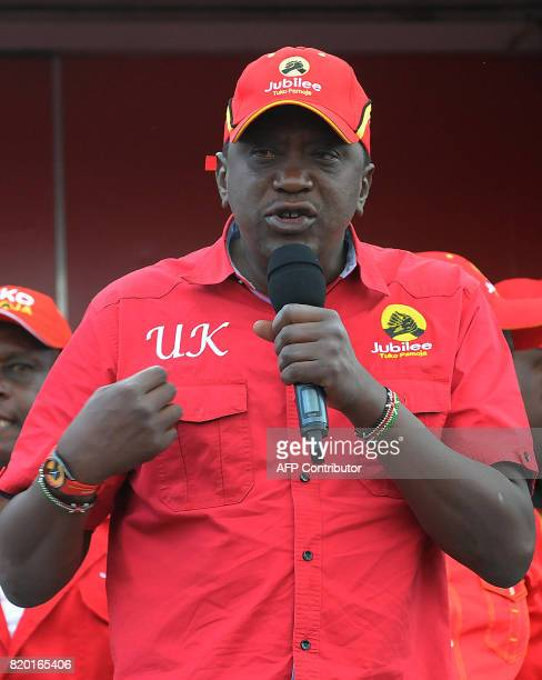 Kenyan President Uhuru Kenyatta addresses supporters during a campaign rally in Nairobi on July 21 2017 ahead of next month's presidential election /...