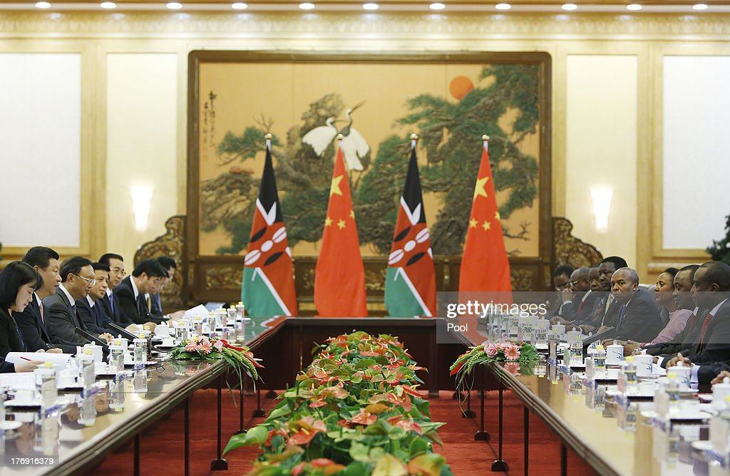 Kenyan President <a gi-track='captionPersonalityLinkClicked' href=/galleries/search?phrase=Uhuru+Kenyatta&family=editorial&specificpeople=2149190 ng-click='$event.stopPropagation()'>Uhuru Kenyatta</a> (2nd R) and his Chinese counterpart <a gi-track='captionPersonalityLinkClicked' href=/galleries/search?phrase=Xi+Jinping&family=editorial&specificpeople=2598986 ng-click='$event.stopPropagation()'>Xi Jinping</a> (2nd L) sit during a meeting in the Great Hall of the People August 19, 2013 in Beijing, China. An agreement was signed between the two countries will allow mutual visa exemptions for holders of diplomatic service passports.