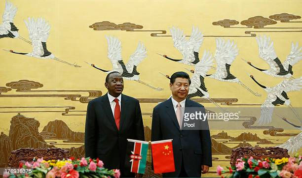 Kenyan President Uhuru Kenyatta and his Chinese President Xi Jinping stand during a signing ceremony for a visa exemption agreement in the Great Hall...